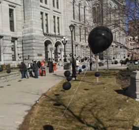 Black Balloons line the side walk outside of the county court house
